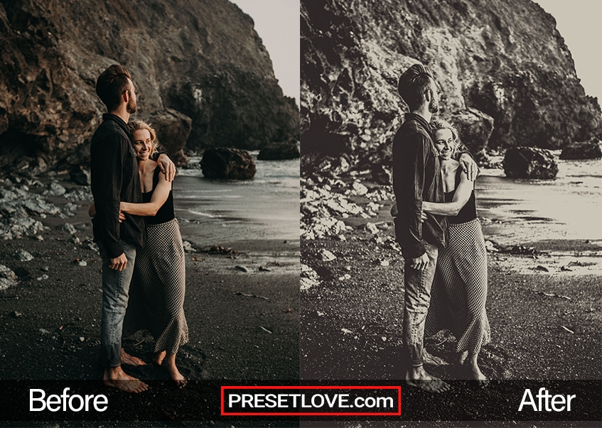 A black and white photo of a couple embracing while at a coast