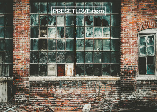 A gritty and grungy image of an abandoned brick building