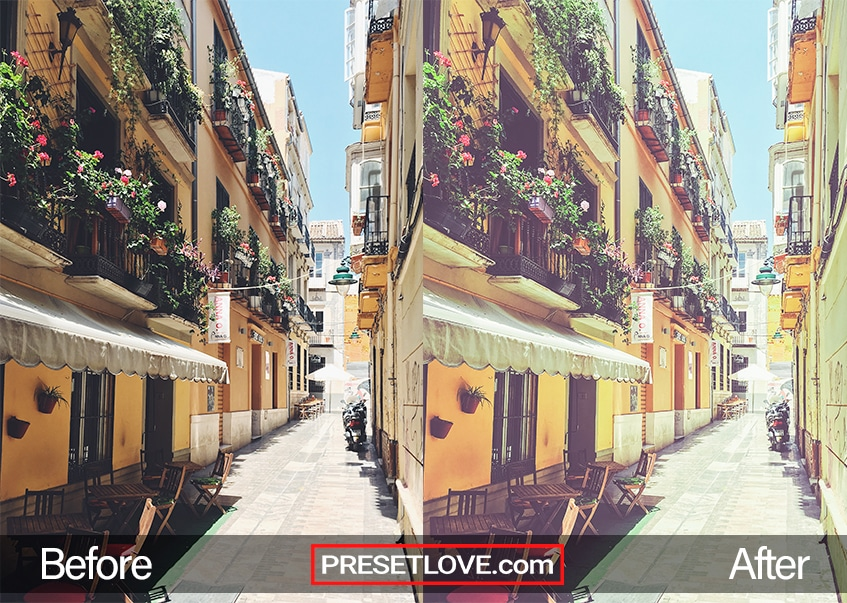 A warm retro photo of a street lined with yellow buildings with flowers in balconies