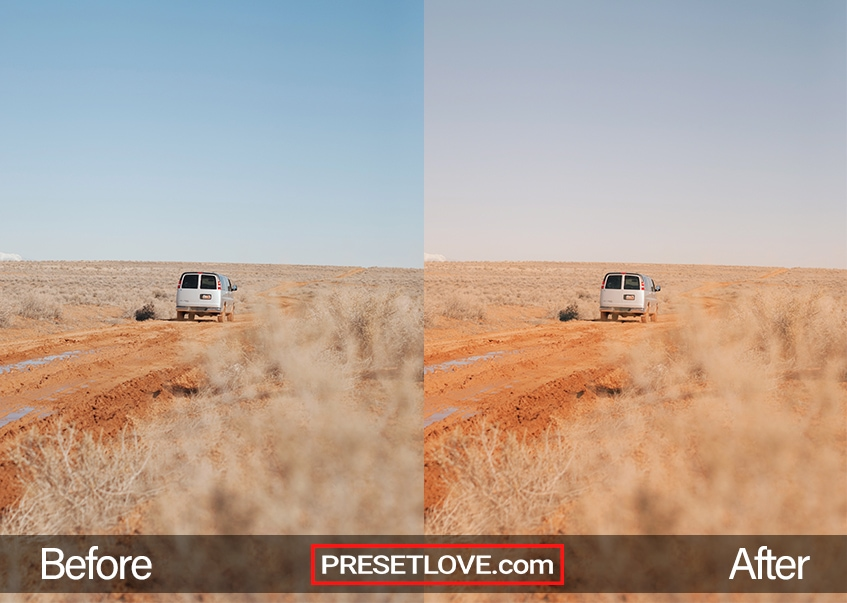 A warm film photo of a van driving in the middle of a barren field
