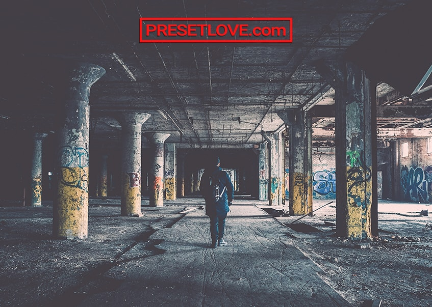 A man walking in an abandoned building