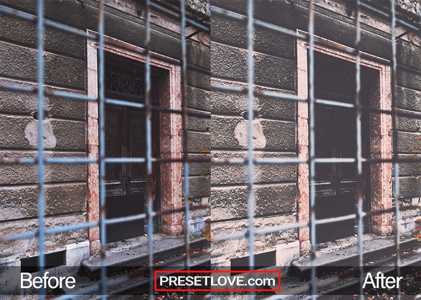 A vintage industrial photo of a cabin wall through a wire fence