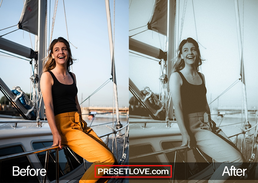 A woman in orange pants sitting on the railing of a yacht