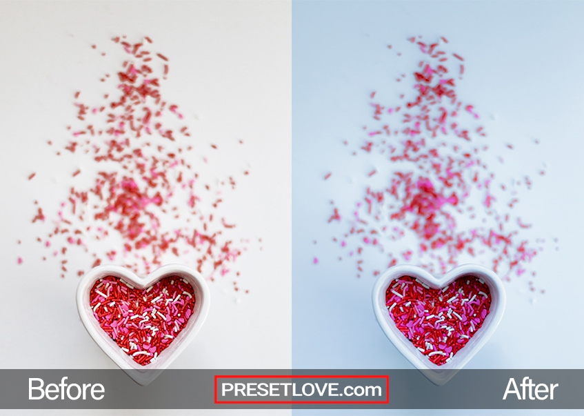A blue-tinted photo of red, pink, and white candy sprinkles in a white heart-shaped bowl