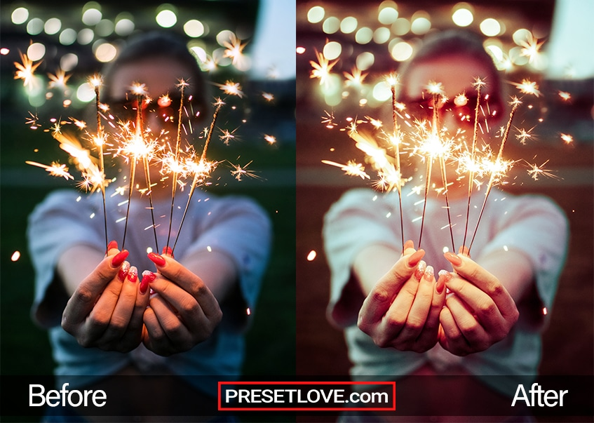 A girl holding up sparklers at the camera