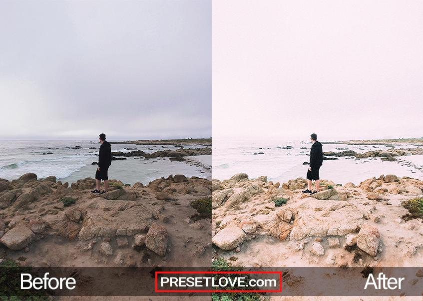 A bright photo of a man wearing a black jacket at a coast