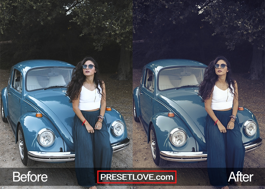 A woman leaning against a blue vintage car