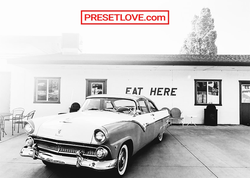 A vibrant black and white image of a vintage car
