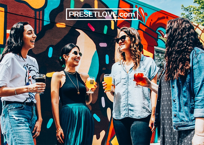 A photo of friends gathered outdoors, enhanced with a vibrant urban free preset by Preset Love