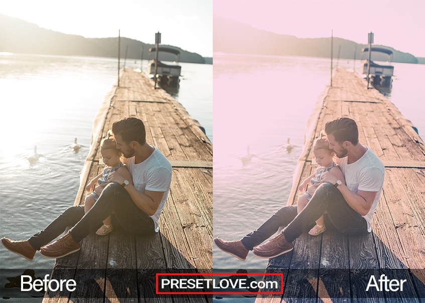 A soft pastel photo of a man with a baby in his arms while sitting at a dock