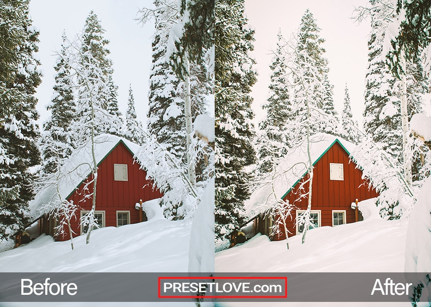 A red cottage covered in snow
