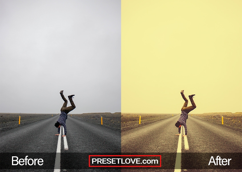A yellowish photo of a man doing a headstand in the middle of an empty road