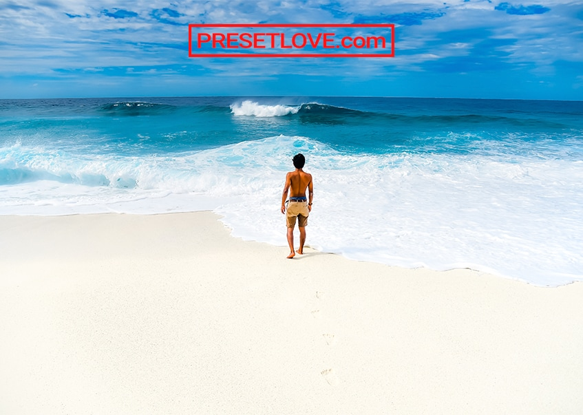 A bright and vibrant photo of a man standing at the beach