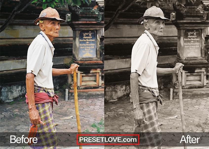 A film monochrome portrait of an old mean walking supported by a bamboo cane