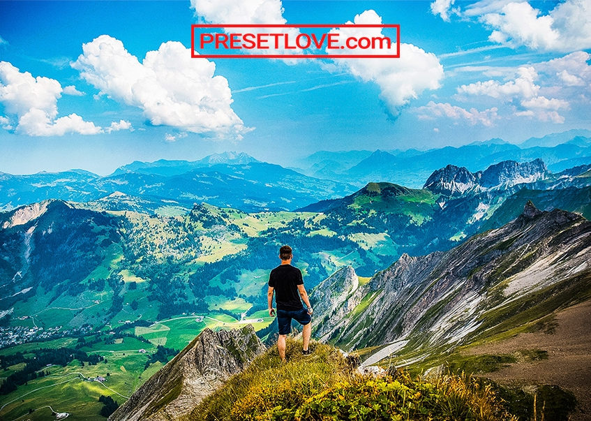 A man on top of a vivid and colorful landscape