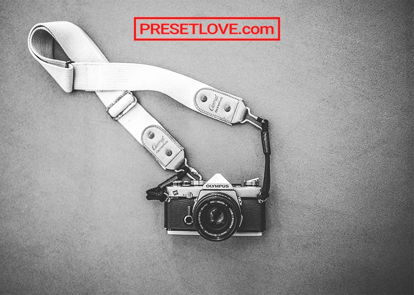 A matte monochrome photo of an analog camera
