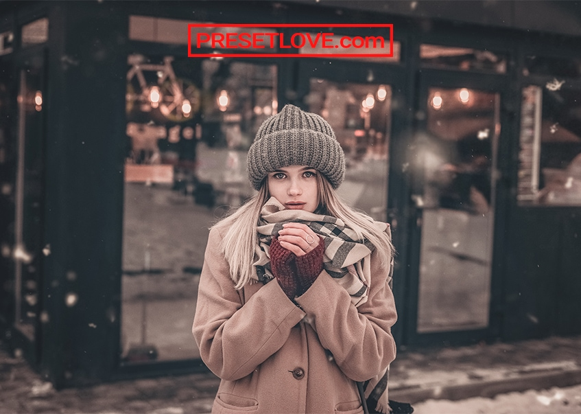A cozy photo of a woman in winter clothing