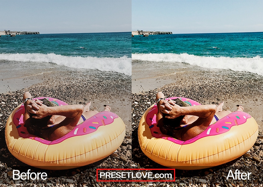 A woman lounging on the beach with a donut inflatable