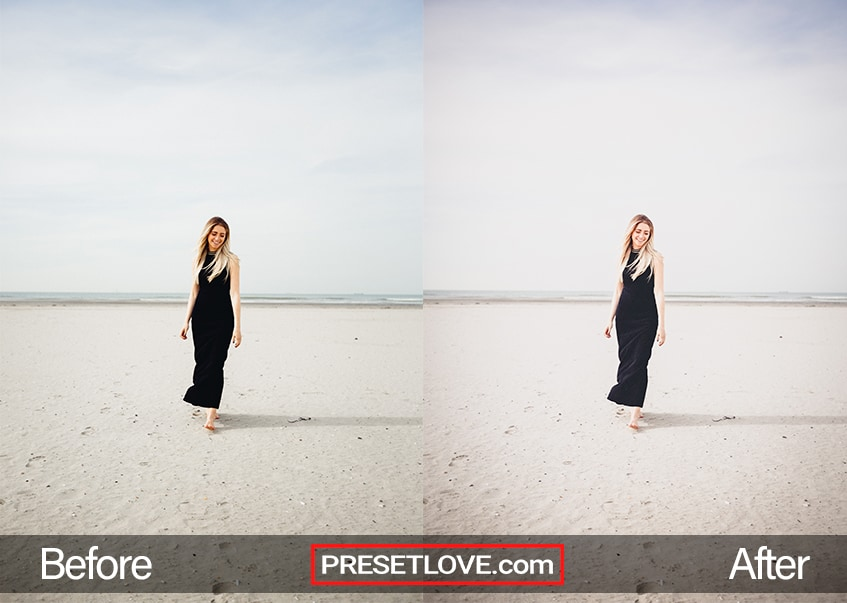 A bright and vivid photo of a woman in a black dress standing on a beach