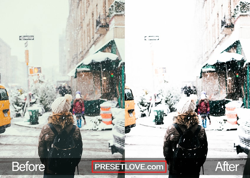 A woman about to cross a road during a snowy day