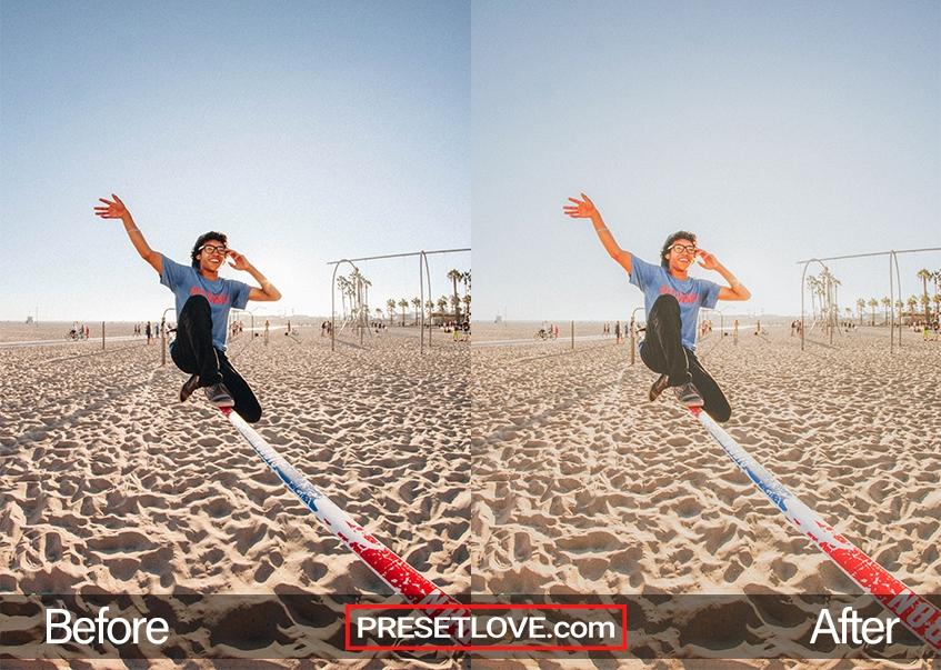 A warm matte outdoor photo of a man balancing on a pole at the beach