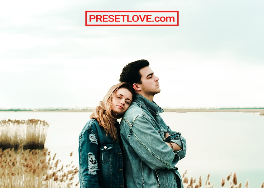A bright photo of a couple in denim jackets