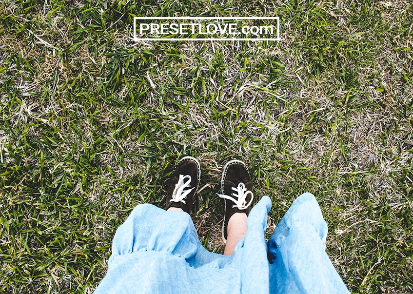 A top-view photo of black shoes on grass