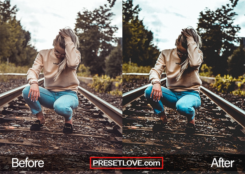 A dramatic photo of a woman squatting on a railroad track