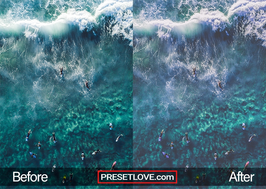 A soft blue aerial photo of people surfing a large ocean wave