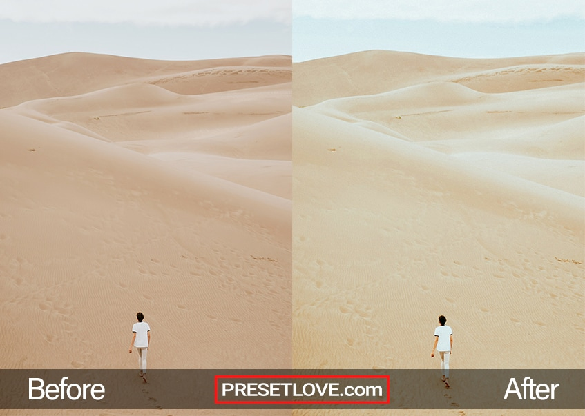 A cool photo of a man in a white shirt walking in the middle of a desert