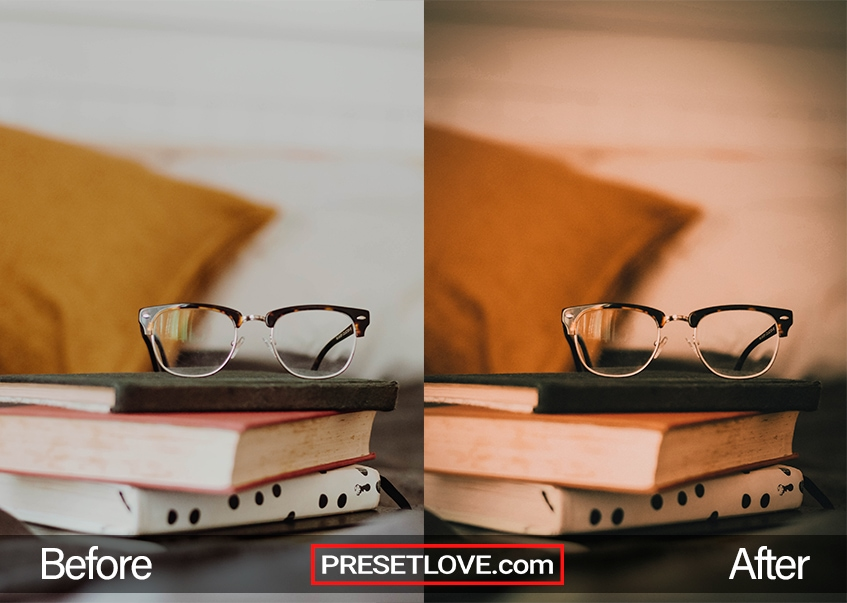 A warm brown photo of eyeglasses on a stack of books
