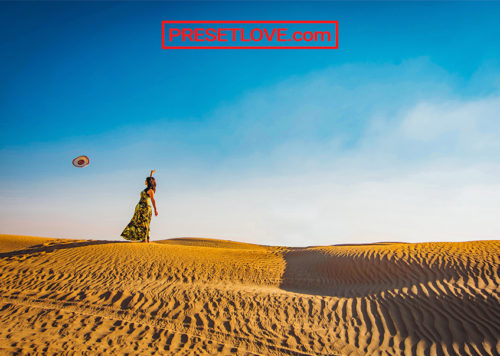 A woman in the middle of a desert
