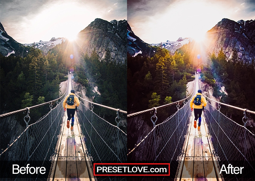 A man in a yellow jacket crossing a hanging bridge