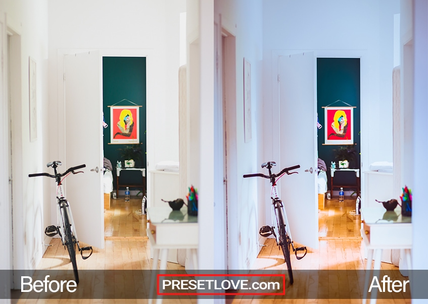 A room with white walls and a bicycle leaning on the left