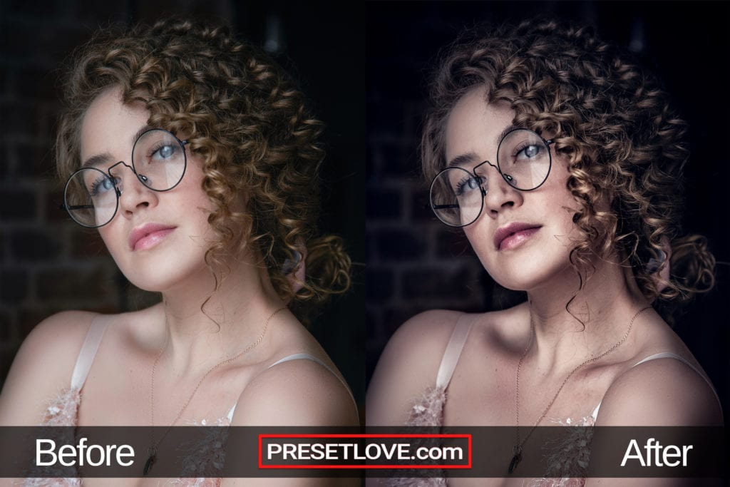 A high-contrast portrait of a woman with curls and eyeglasses