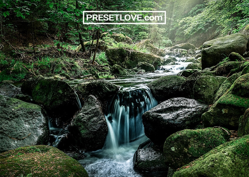 A vivid landscape image of a waterfall
