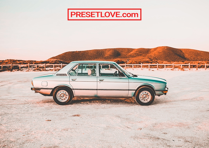 A vintage car photo with orange and teal preset treatment