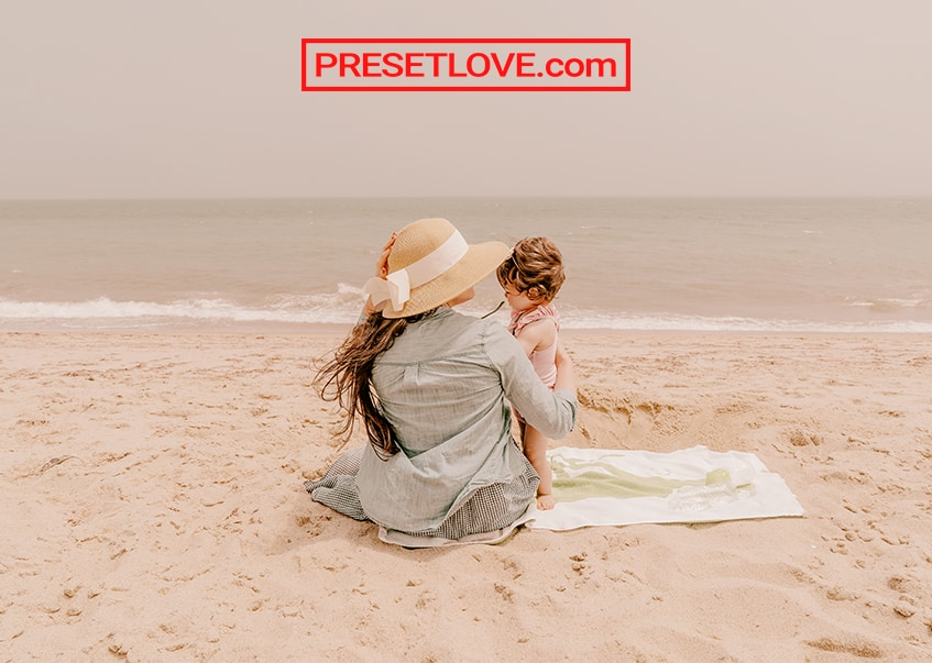 Pastel photo of a mother and child at a beach