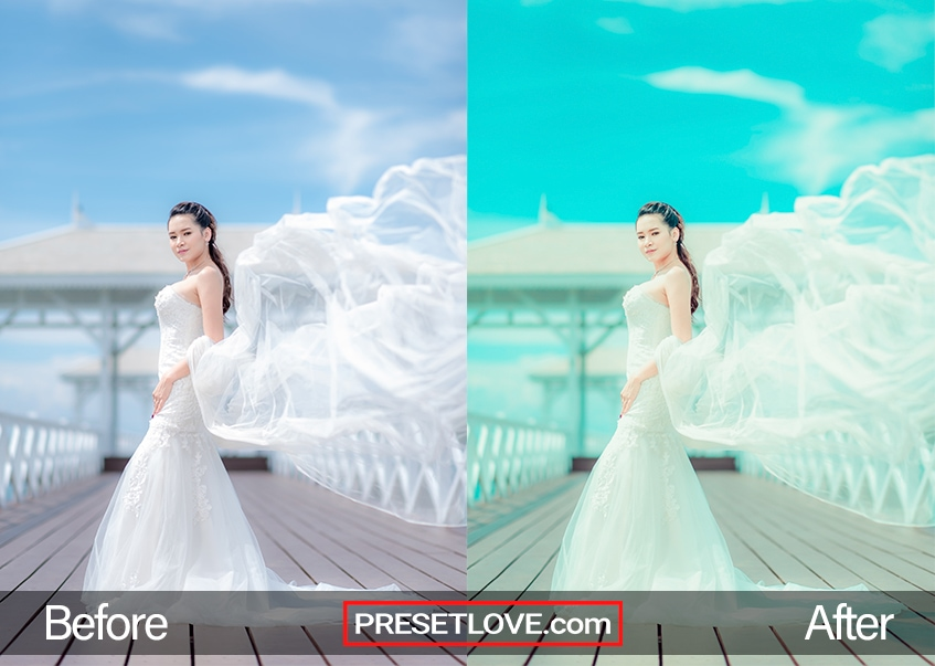 Exotic bridal photo on a dock with wind-swept train and blue sky
