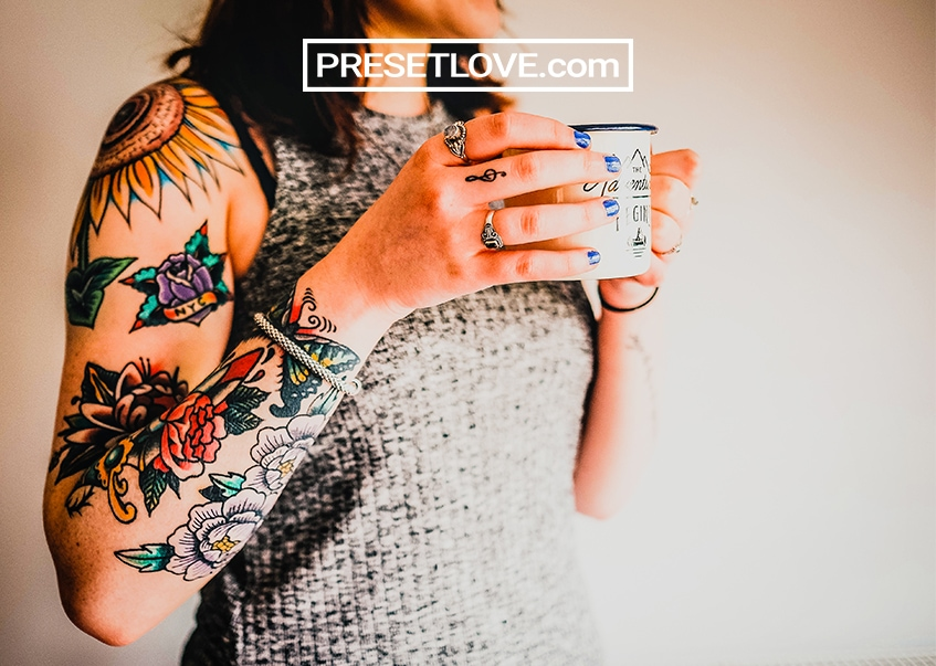 Enhanced Floral Tattoo on Woman's Right Arm
