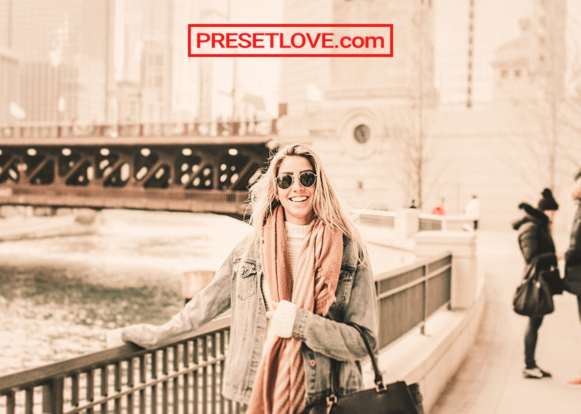 Warm Pastel travel photo of a woman wearing a coat and peach scarf