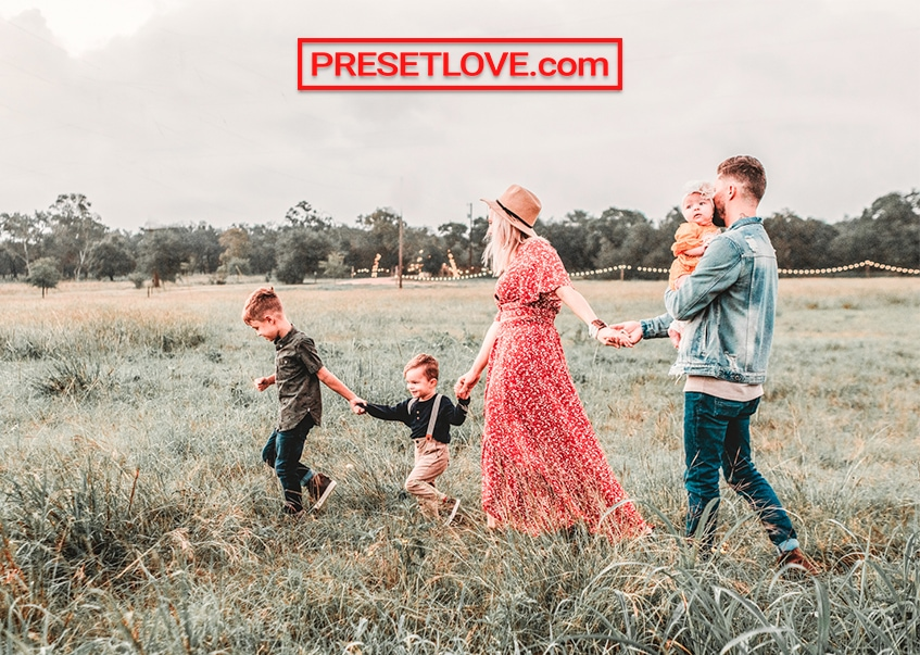 Outdoor portrait of a family in the fields