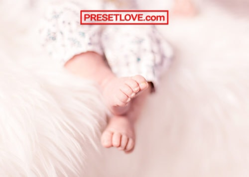 A warm and soft photo of a baby's feet