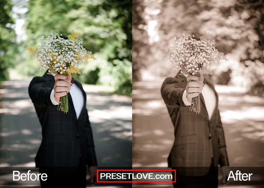 A soft sepia photo of a groom holding up a bouquet