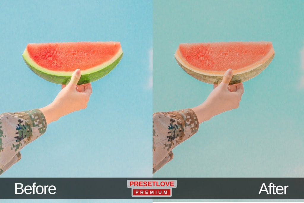 A warm photo of a hand holding up a slice of watermelon