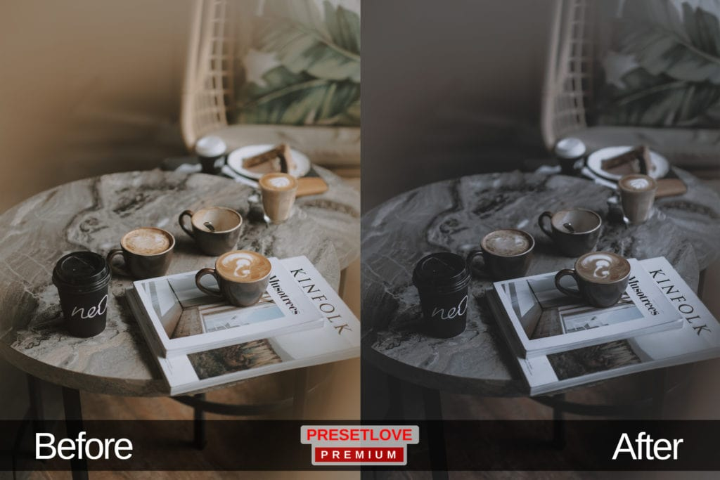 A dim and cozy cafe setting with cups of coffee and white magazines on a wooden table