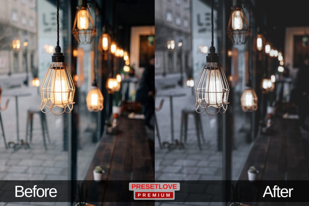 A dim and cozy cafe with light fixtures hanging in a row