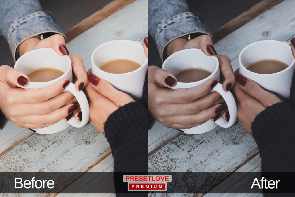 A dim but cozy photo of two people holding white mugs of coffee in their hands