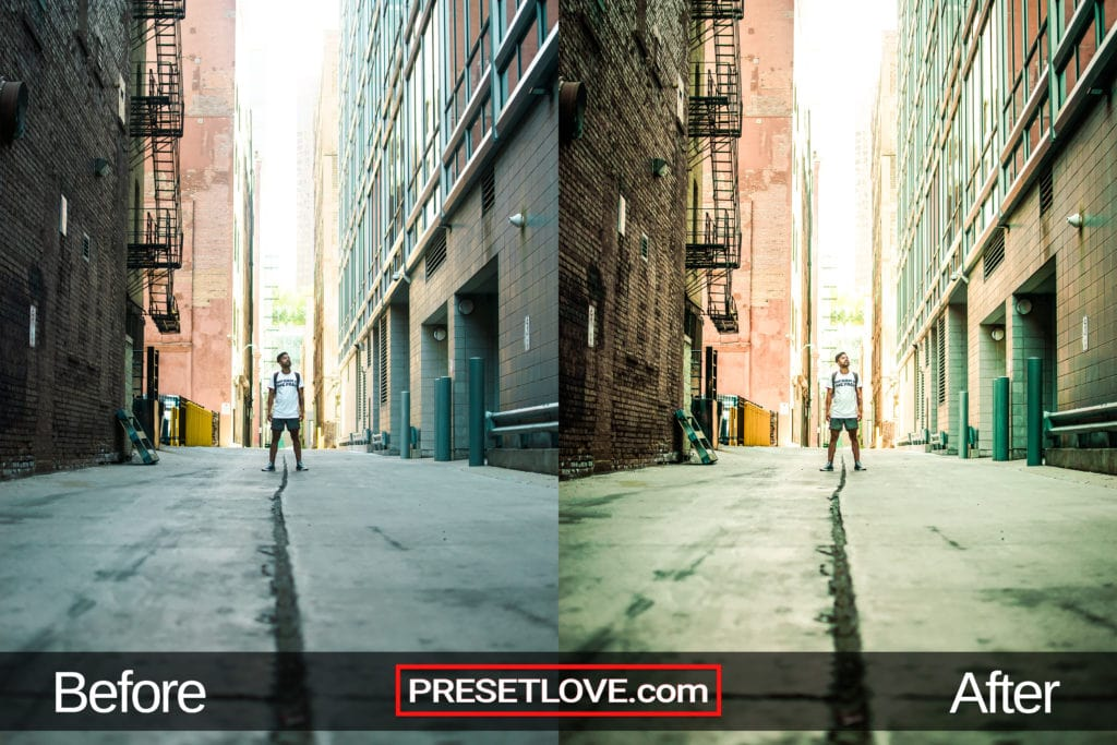An urban photo of a man standing in the middle of an empty street, with a warm and vibrant preset applied