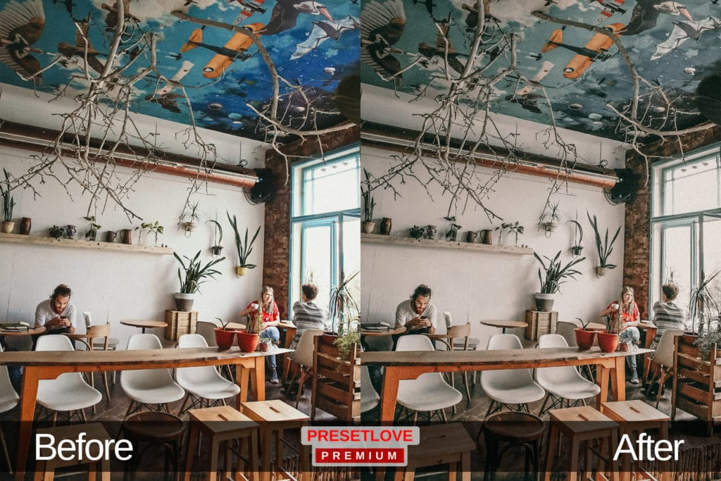 A light and airy photo of a cafe with airplanes painted on the ceiling